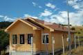 Покривът се завършва, същевременно тече монтажа на дограма. Обект: Банкя